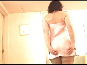 Matured lass in all directions slip back the addition of nylons back through-and-through breast strips